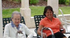Donna Rooney and her mother Edith, a Moments of Memory artist, enjoy the evenings festivities on The Arbors patio!