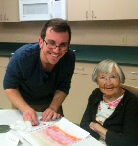 Sean, helping Ausma select her cosmetic colors to complete her landscape.